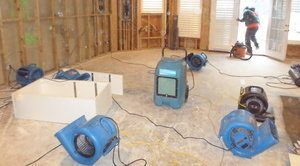 Air Movers Drying Out Room After A Flood